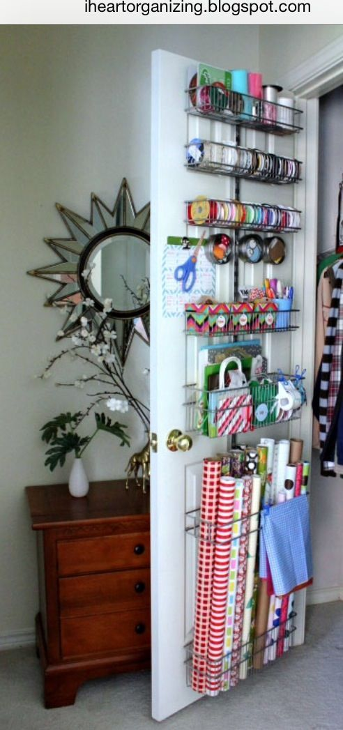 Organize your gift wrap with the help of hardware from the Container Store and advice from iheartorganizing.blogspot.com