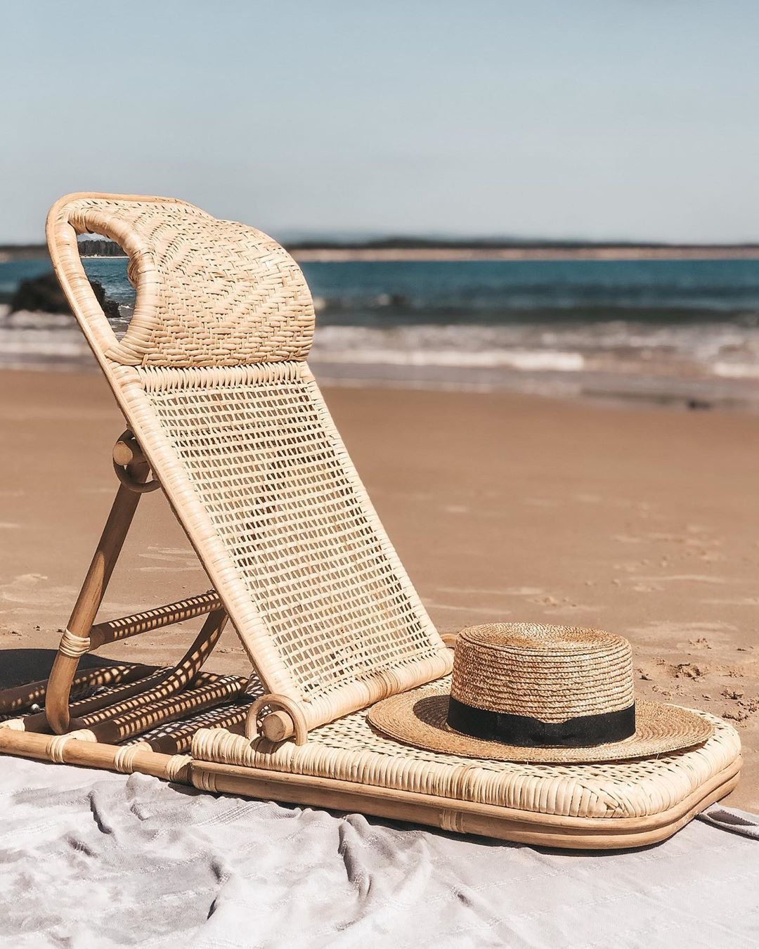 Sol Lounging Fridays Were Made For This With Land And Sand Essentials Beach Beach Umbrella Rattan Beach Chair