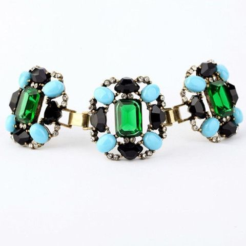 Green Blue Black Gemstone Statement Bracelet. Dress up your wrist with this fabulous faux gemstone studded bracelet, set with green faceted emerald, turquoise and faceted black onyx style acrylic jewels, plus clear diamante style stones against a bronze vintage effect setting.  Measures approximately 16cm. Faux gems. Metal alloy. Nickel and lead free. #jewellery #jewelry #bracelet #gems #stones #stylish #statement #jewels #retro #style
