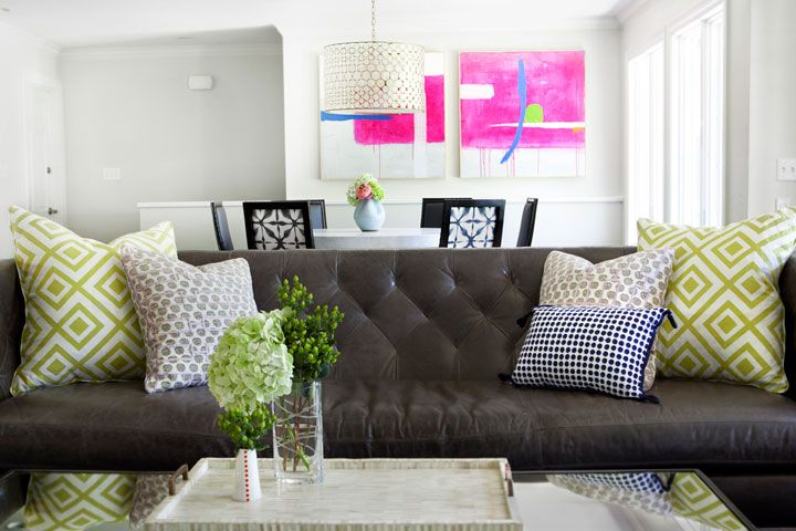 Stunning Living Room Features A Brown Leather Tufted Sofa Topped
