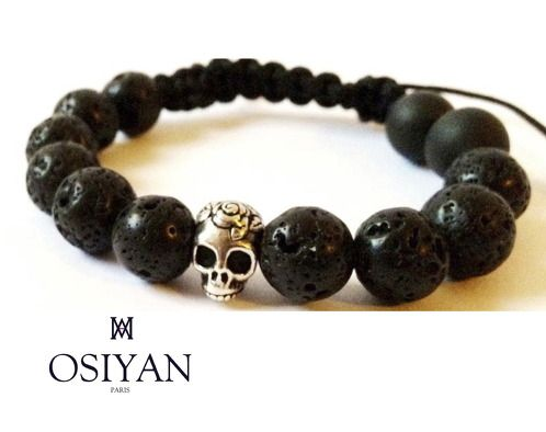 https://www.cityblis.com/7451/item/12562  Bracelet with lava rock beads and silver skull - $80 by Osiyan Paris  This bracelet is made with beads from Lava rock and a silver skull head 925/1000e. Black Nylon cord is used to ensure the highest degree of quality and durability of the product. This bracelet is unisex and the size is adjustable Handmade in France   Ce bracelet est fabriqué à base de perles e...