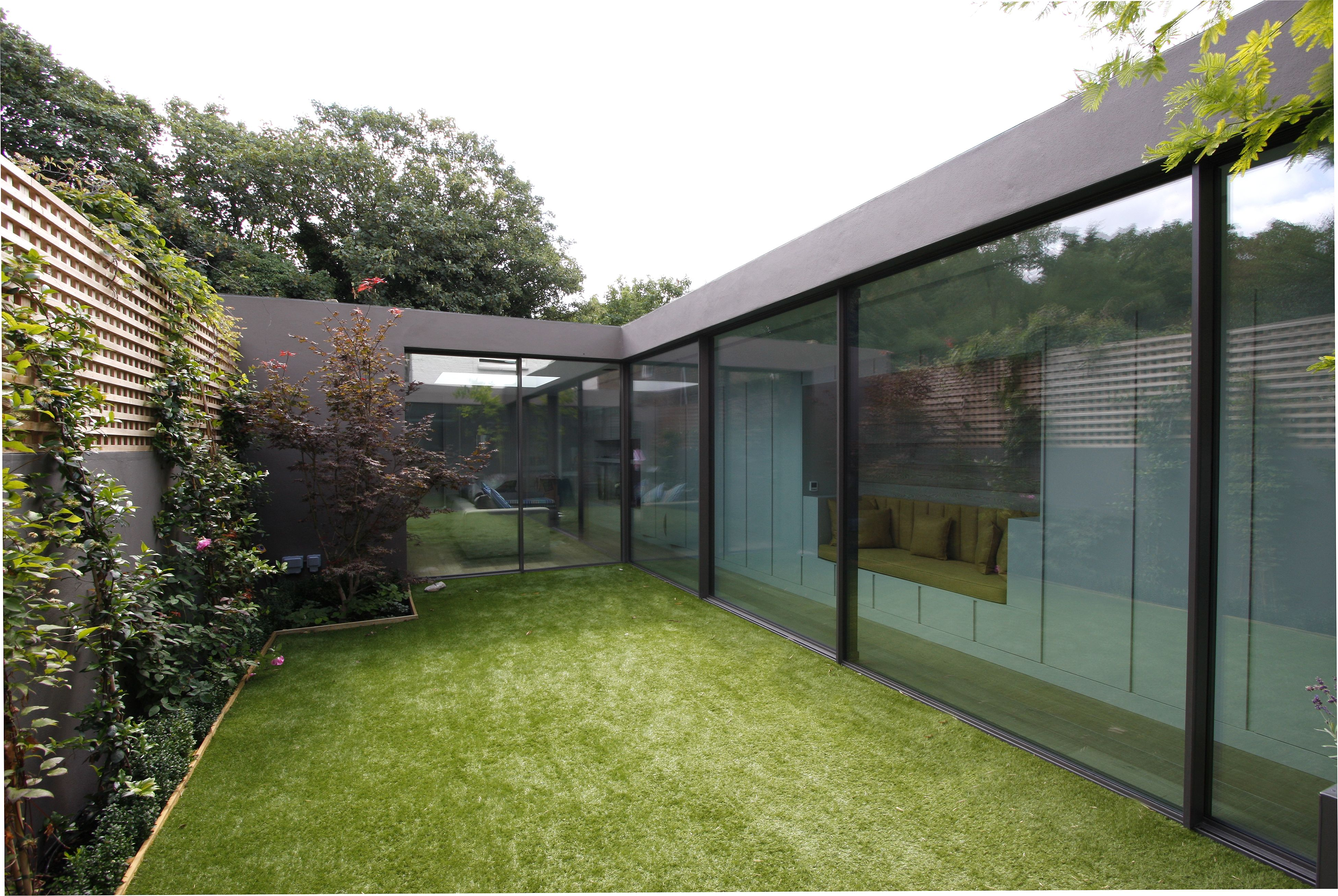the minimal windows sliding doors, as used on this project, are flush with the floor and have a 21mm vertical sightline to create a minimal framed sliding door www.iqglassuk.com