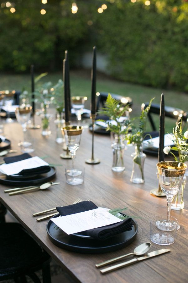 Black linens and napkins and brass tulip candle holders: http://www.stylemepretty.com/living/2016/11/11/a-moody-and-glamorous-fall-dinner-party-under-the-stars/ Photography: Carla Choy - http://www.carlachoyphoto.com/