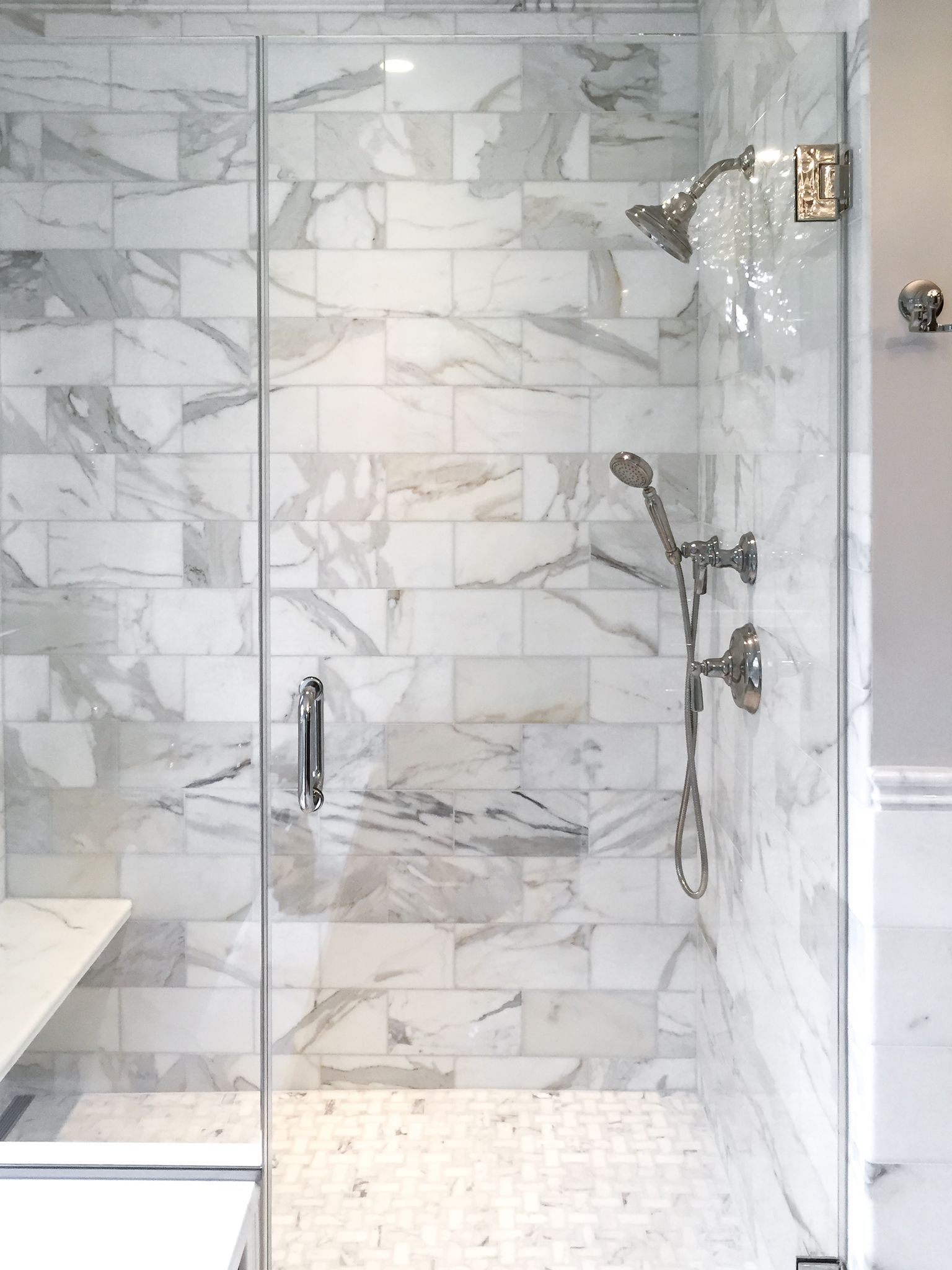 artistic tile i this master bathroom is
