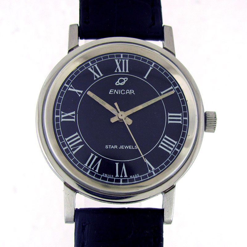 ENICAR STAR JEWELS MANUAL WINDING WATCH  Feature : Center Second, Engrave on Back Cover and Manual Winding Dial Features : Repainted Dial Dial Color : Black Markers : White Roman Figures Case Material : Standard Stainless Steel Case Crown : Pull Band Type : Leather Hands : Steel Luminescent Hands Movement : Manual Winding Gender : Gents Machine No. : 160 Back No. : 140-39-05 Serial No. : - Jewels : 17  Case Diameter Size : 3.5 cm Side To Side Size : 3.7 cm (Including Crown)