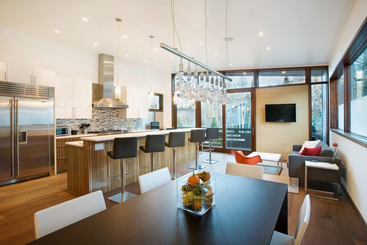 Kitchen And Dining Room Of Small Contemporary House In Swiss Style