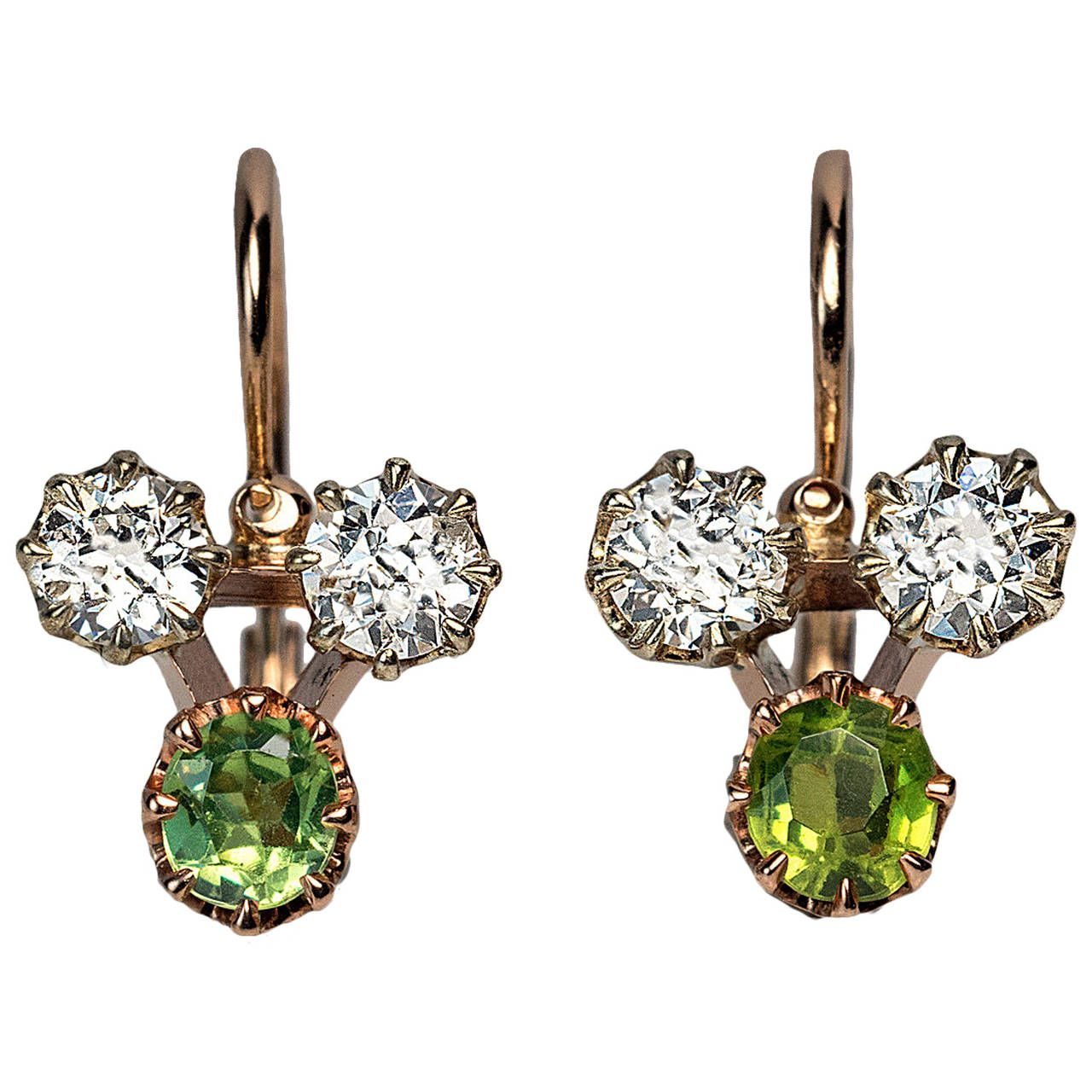 Antique Russian Demantoid Diamond Gold Earrings. Made in Moscow between 1899 and 1908 The 14K rose gold earrings are set with four old European cut diamonds and two Russian demantoids.
