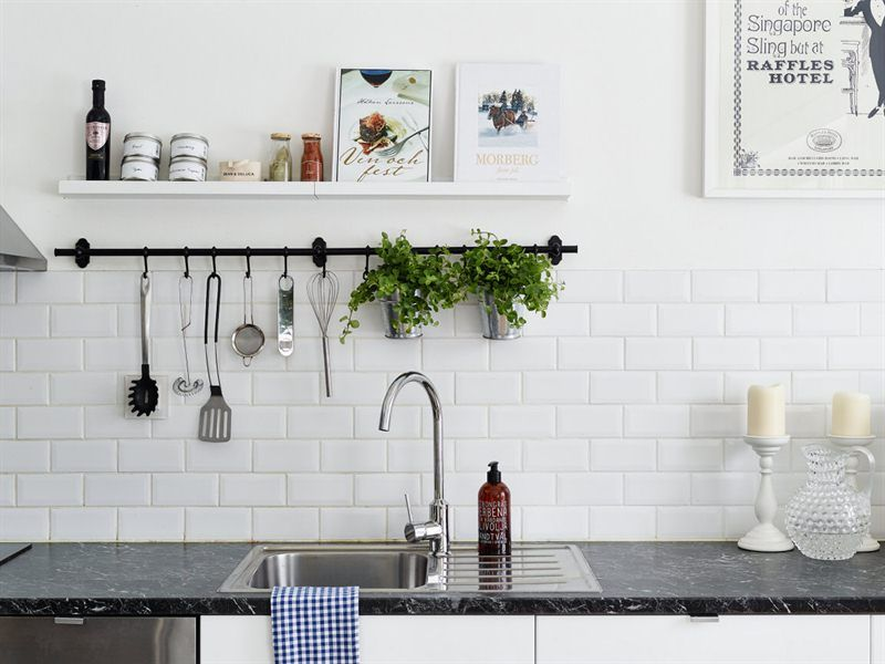 white cabinets dark marble top and subway tiles apartment interiormountain