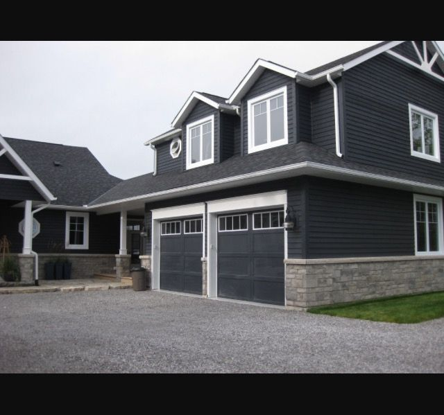 Slate Gray Siding With Rock And White Trim