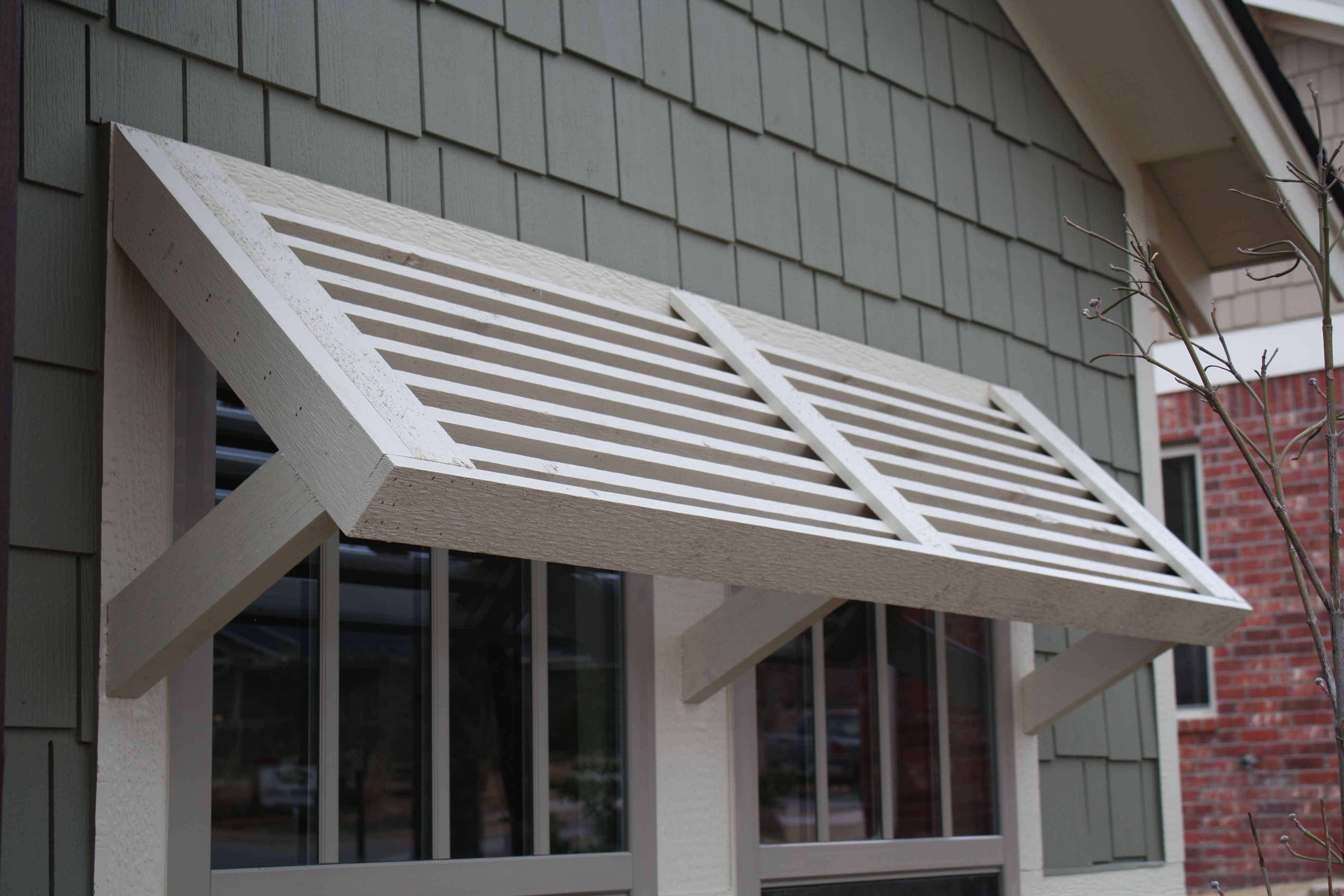 Beautiful Window Details Used In Our Bungalow Homes Www Mccalebhomes Com Shutters Exterior Shade House House Exterior