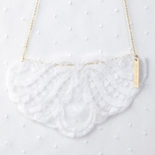 Create a family heirloom by turning a piece of your wedding gown into a beautiful lace necklace.