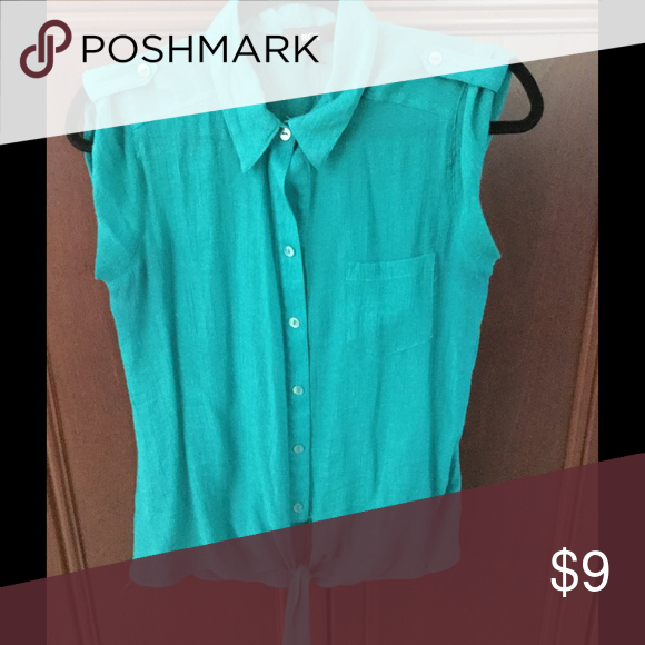 Women's Top Light weight top. Ties at bottom. Teal color. 62% Rayon 38% Polyester. Tops