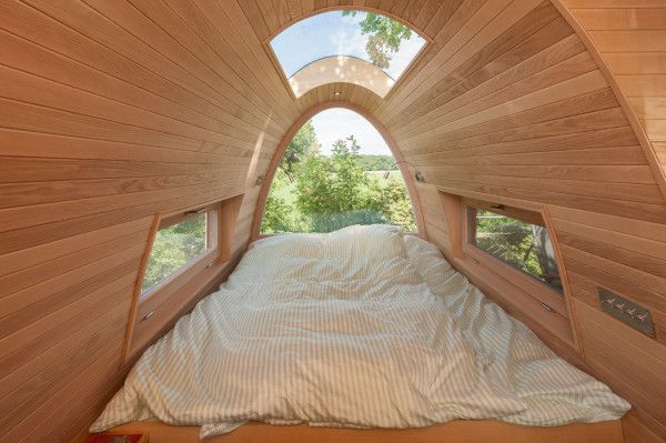 This tree house has adouble bed fitted within the domed shape.