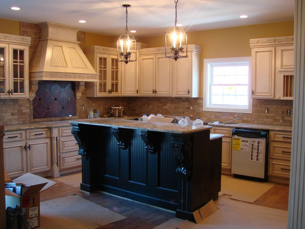Off White Kitchen Cupboards getting closer! white glazed cabinets. dark two-tier island, brick