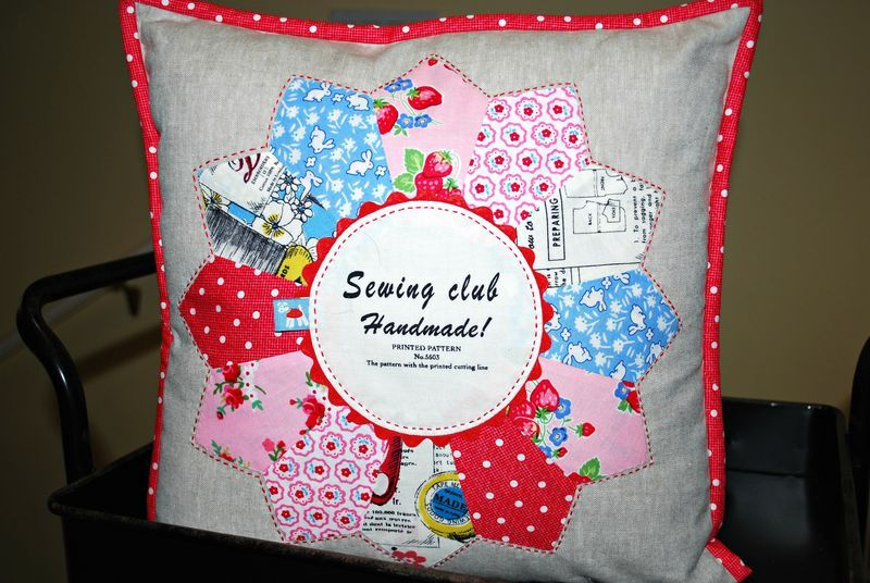 Suzanne from Strawberry Patches cute pillow.. that Pam Kitty fabric looks so good with all the other pieces.