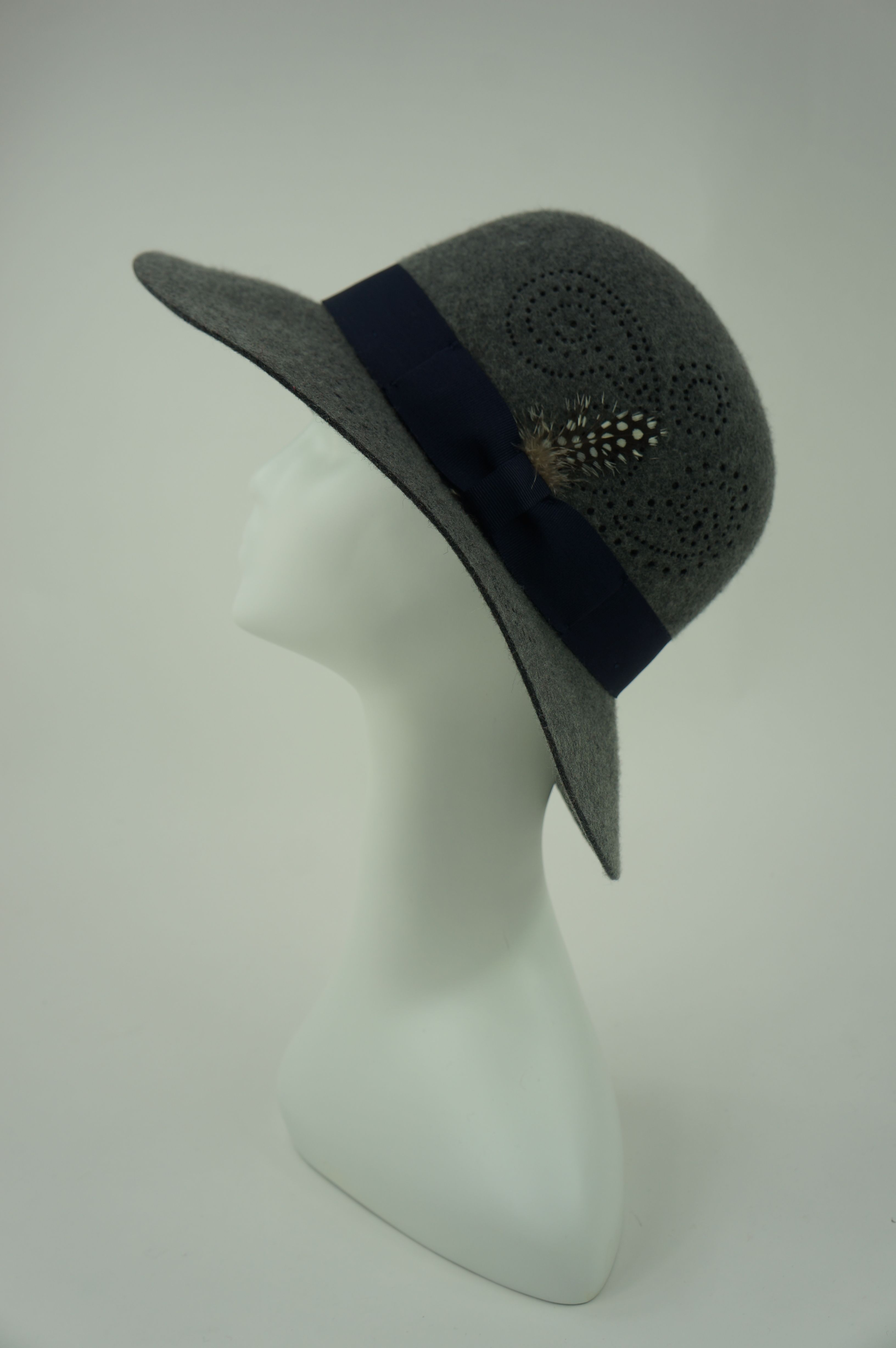 Helen -- Unique wool felt fedora with a perforated paisley pattern. Grosgrain band and feather detail.