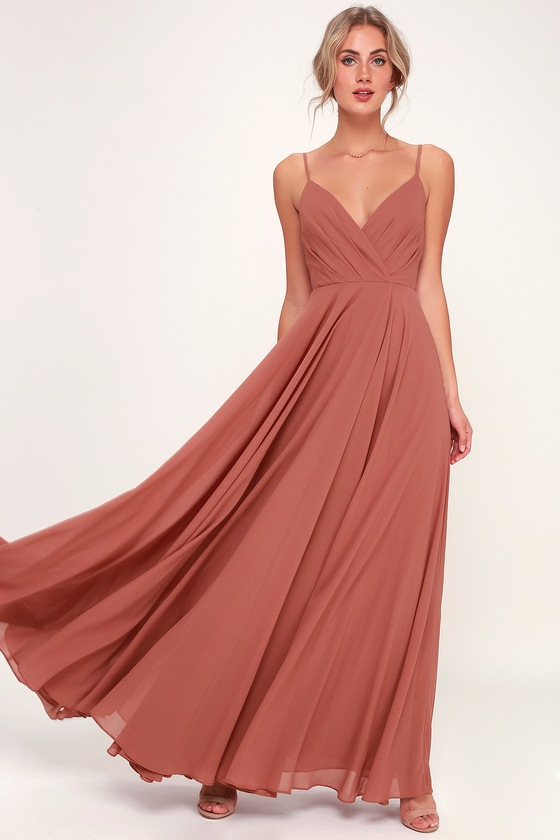 22e8be6bea451 All great love stories start with the All About Love Rusty Rose Maxi Dress!  Woven poly shapes a pleated, surplice bodice, and maxi skirt.