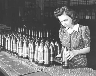 A women working in a factory making weapons for our troops during WW2.