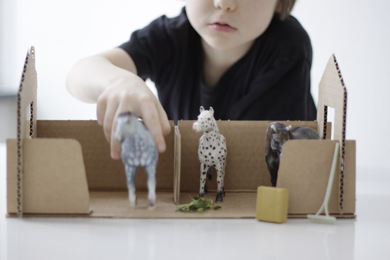 cardboard stables made from a shoebox