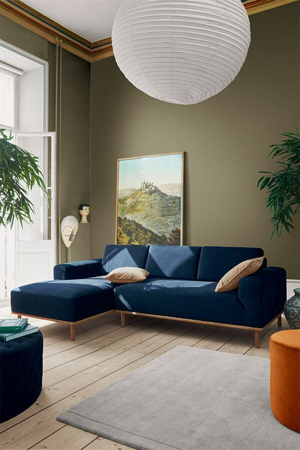Photo of Blue velor sofa that steals the show