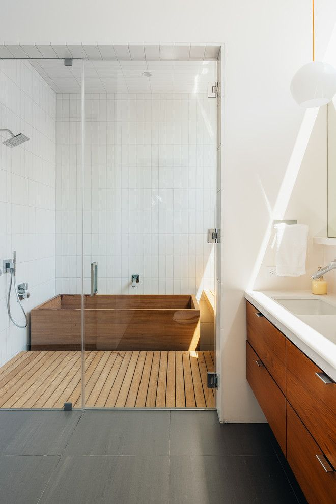 18 Modern Glass House Exterior Designs: Amazing Contemporary Master Bathroom Featuring White Walls