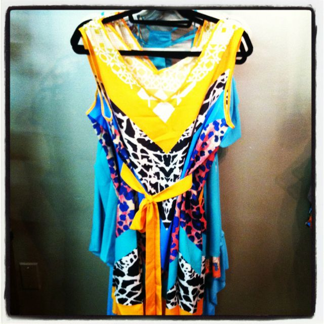 L-O-V-E this new dress we just got in today!!! From the vibrant colors to all the funky mixed prints this dress will DEF stand out in a crowd!!