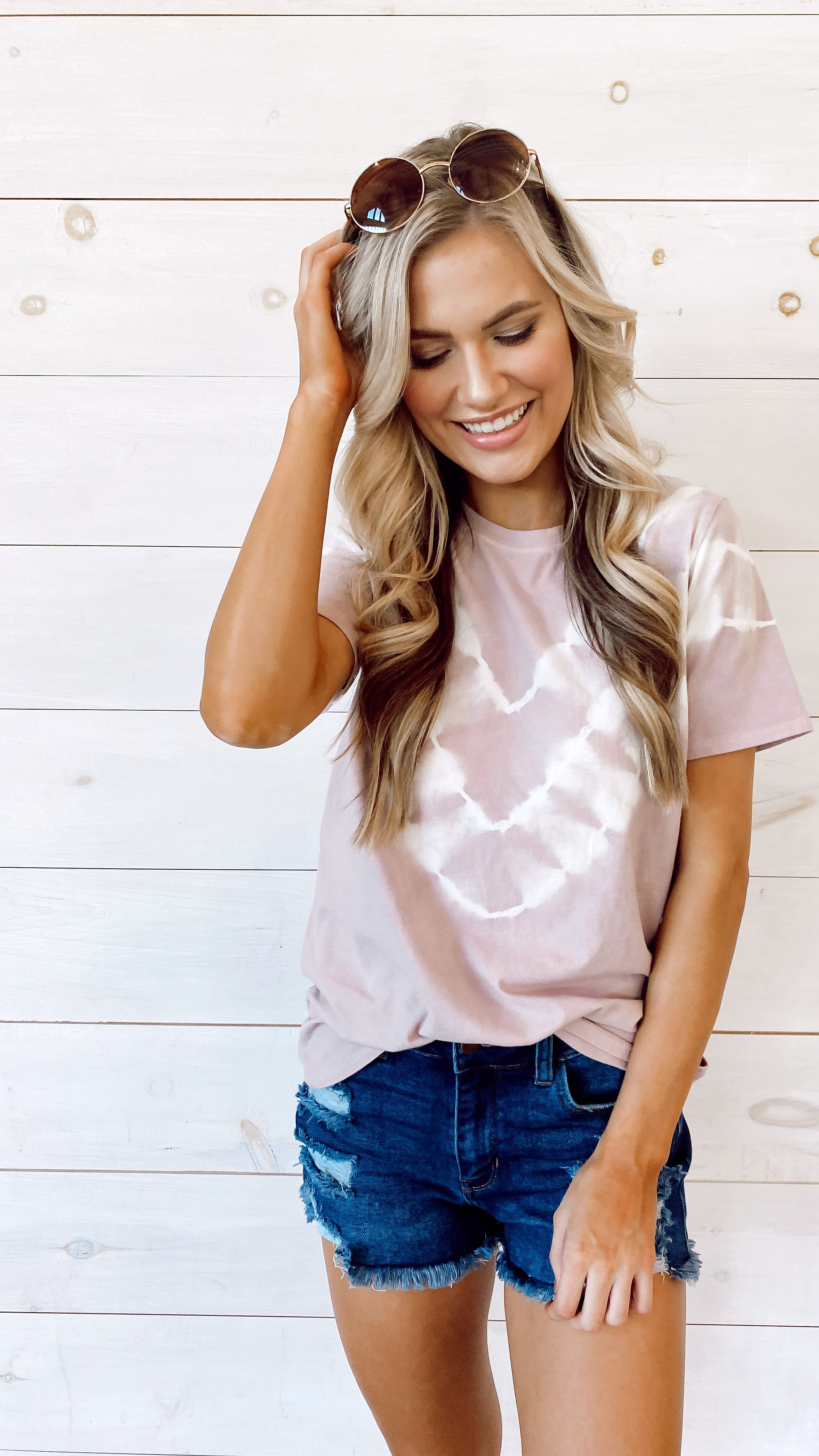 Stay on-trend with the Harper Tie-Dye Tee! You'll have this style on repeat all year with its versatile tie-dye print, relaxed fit, and soft + stretchy knit fabrication. Style it now with shorts and sandals or your favorite PJ pants for lounging around the house! #tiedye #tiedyetop   Soft + Stretchy Knit Fabrication Tie-Dye Print Short Sleeves Crew Neckline Relaxed Fit 96% Cotton, 4% Spandex Hand Wash Cold, Hang Dry Model is 5'6