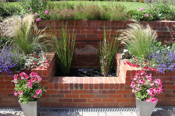 12 Smart Ideas To Use Bricks In Garden Design Garden Design Brick Planter Landscape Design