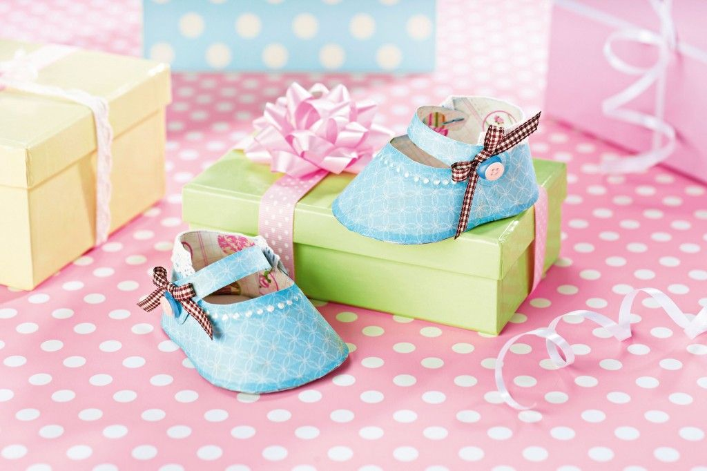 Make these cute 3d paper baby shoes to celebrate a new for Baby shower paper crafts