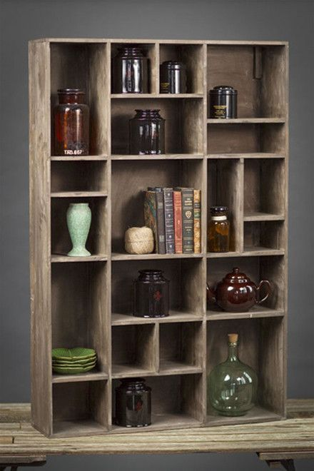 Display your most prized trinkets, treasures and books with this substantial rustic recycled pine wood wall cubby. The charming shelving unit stands just shy of 4 feet tall and features twenty artfull