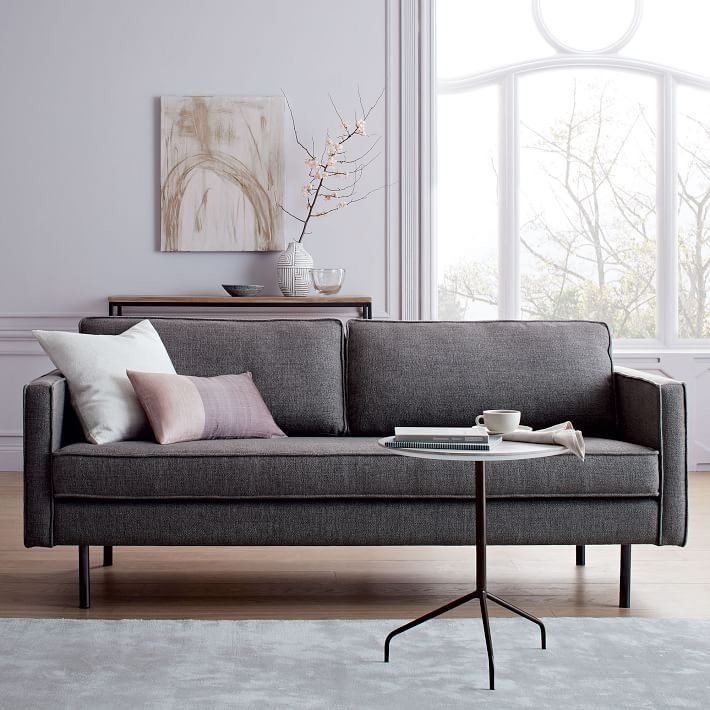On A Simple Industrial Form Standing On Modern Metal Legs Our Axel Sofa S Bench Cushioning And Tex West Elm