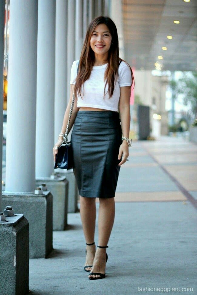 Asian girl in black leather pencil skirt ankle strap heels white cropped knit  top