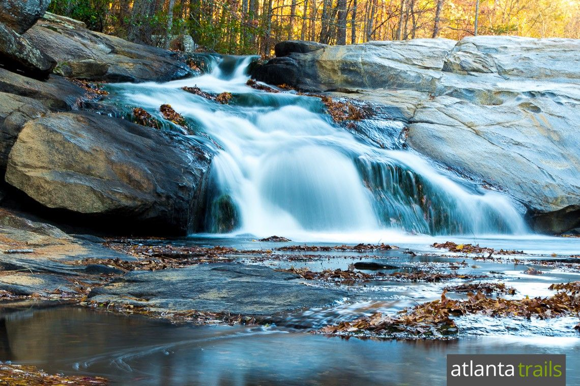 Hike 4.8 miles to the beautiful Henry Mill Falls waterfall in Cochran Mill Park, 25 miles southeast of Atlanta.