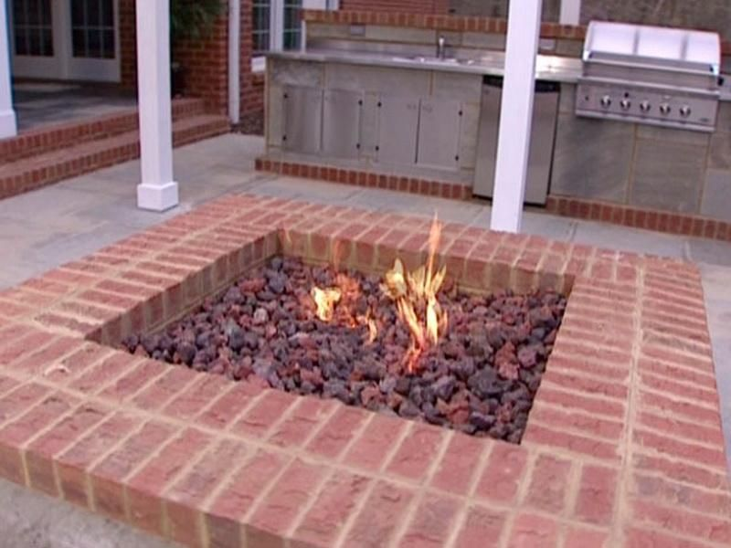 Diy firepit how to create outdoor gas fire pits how to for Fireplace on raised deck