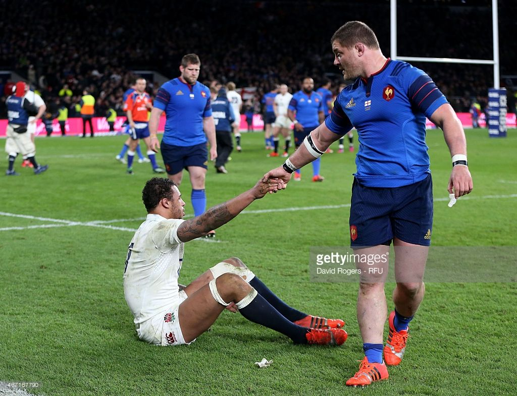 Thierry Dusautoir of France squares up to Mike Brown of