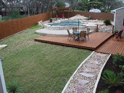 backyard view of deck, pool, pergola, river-rock trails - like the