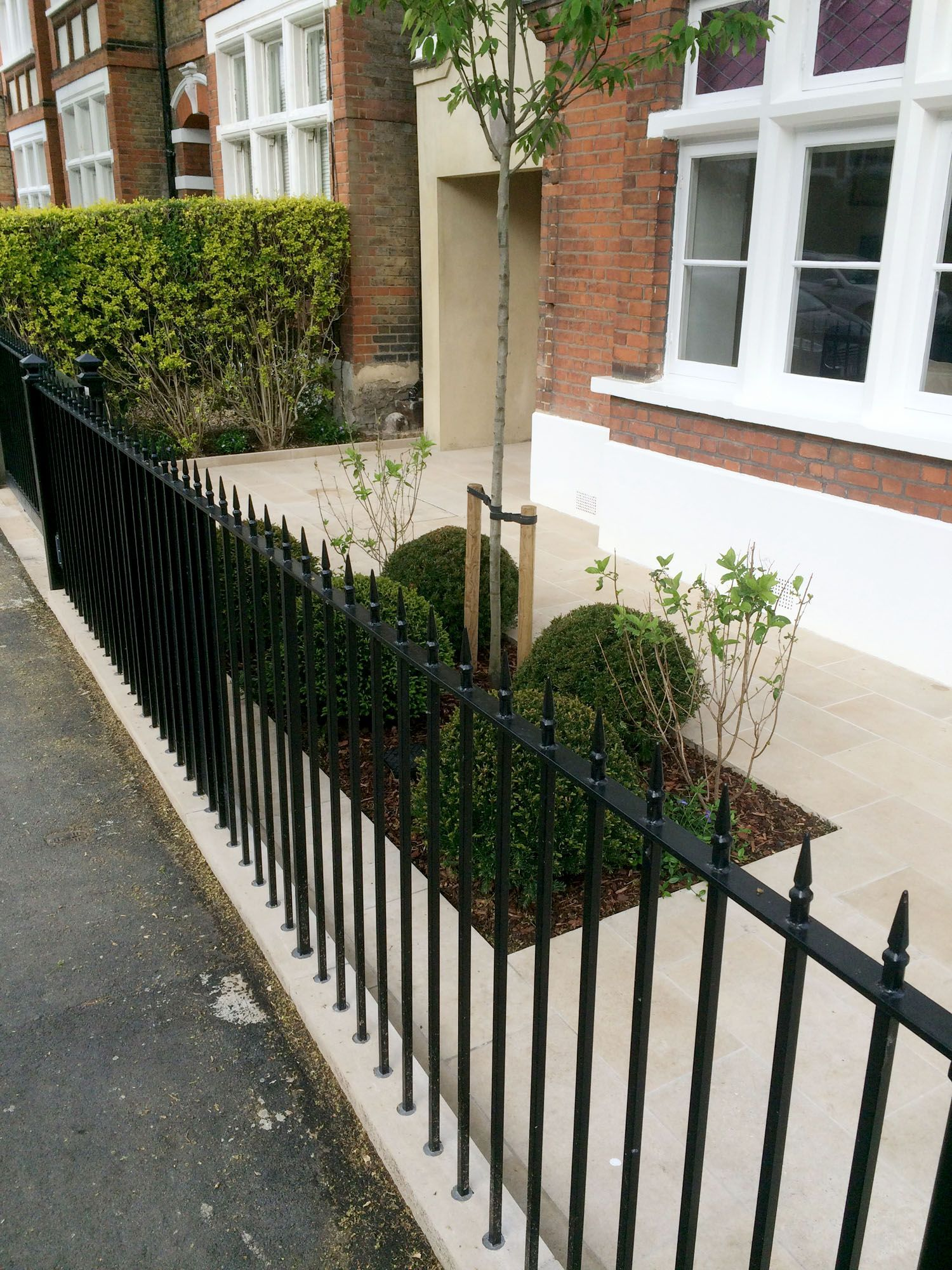 Solid black, cast iron style railings make this London Front