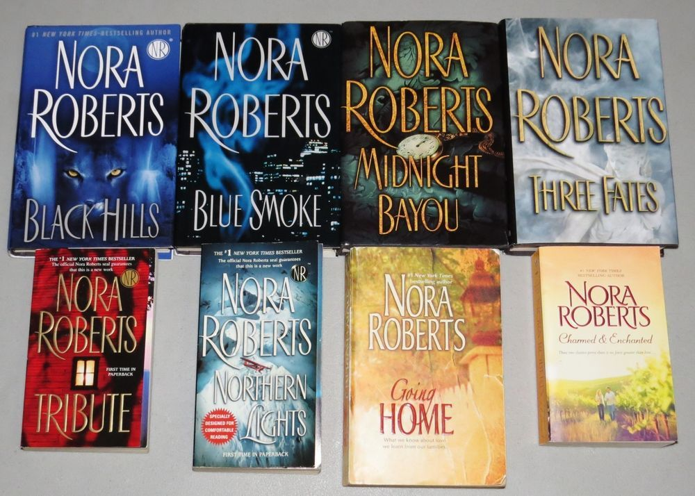 "NORA ROBERTS Book LOT Three Fates Blue Smoke Black Hills Tribute Books Novels All are in excellent condition, most read only once. Going Home is in good condition. No writing. Just more worn than the others and is a bit older. 4 hardcover and 4 softcover books (11 total stories) by Nora Roberts called ""Black Hills"", ""Blue Smoke"", ""Midnight Bayou"", ""Three Fates"", ""Tribute"", ""Northern Lights"", ""Charmed & Enchanted"", and ""Going Home"". ""Charmed and Enchanted"" contains the Donovan Legacy novels…"