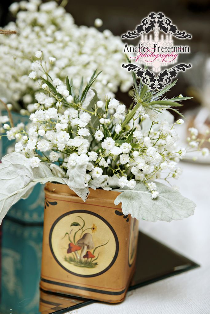Reception tablescapes with low baby's breath centerpieces in vintage tin. Classic Shabby Chic Fall Wedding. Photography: Andie Freeman Photography www.TheAthensWeddingPhotographer.com Wedding Planning and Coordinating: www.WildflowerEventServices.com Venue and Floral: The Thompson House and Gardens