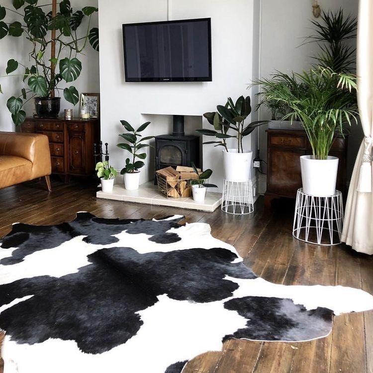 C O W P R I N T What A Statement This Black And White Cow Print Rug Is What We Wan Cowhide Rug Living Room Modern Cowhide Rug Living Room Rugs In Living Room