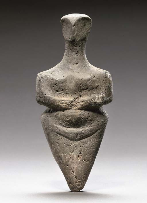 mini-girlz:  A EUROPEAN NEOLITHIC POTTERY STEATOPYGOUS IDOL CIRCA 5TH MILLENNIUM B.C. With long neck and stylized head, wide shoulders with arms bent in front and resting just below small breasts, the wide hips with pubic triangle delineated and legs tapering to a point below 9¾ in. (25cm.) high via >christies.com