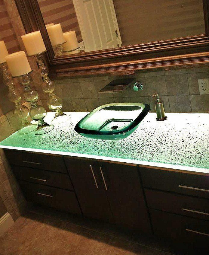 bathroom with glass counter and vessel sink # ...