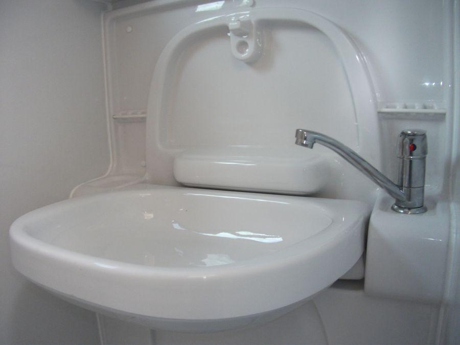 Fold away bathroom sink bathroom design ideas for Folding shower for small bathrooms
