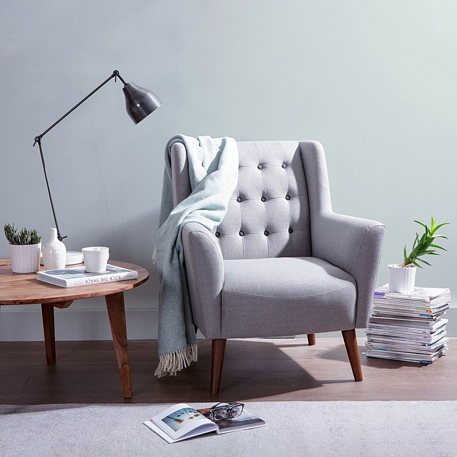 Exude Mid Century Style When You Recline In The Refined Comfort Of The  Classic Abel Light Grey Black Button Armchair From Zanui.