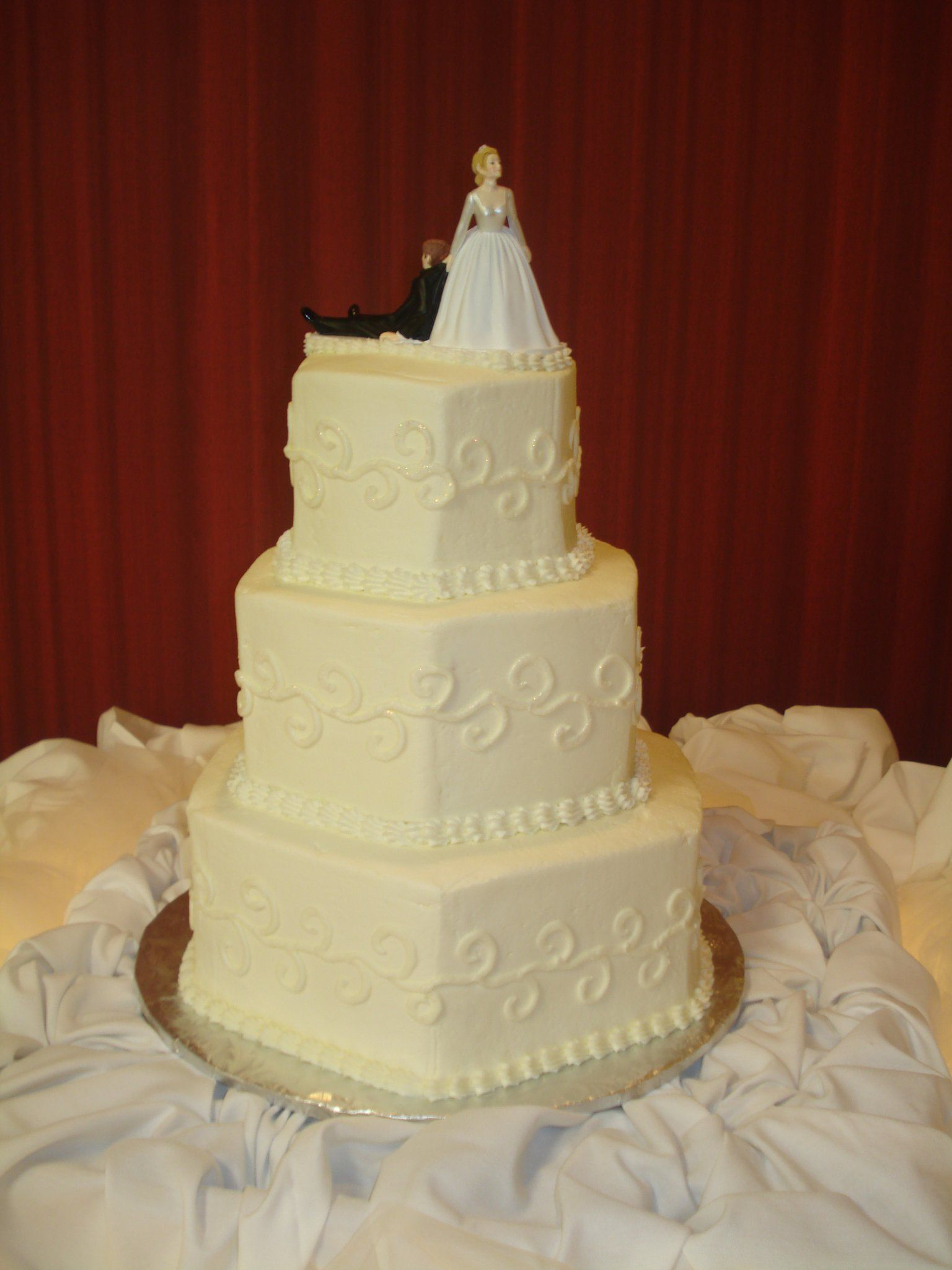 Hexagon wedding cake with cheesy bride and groom topper :)   Wedding ...