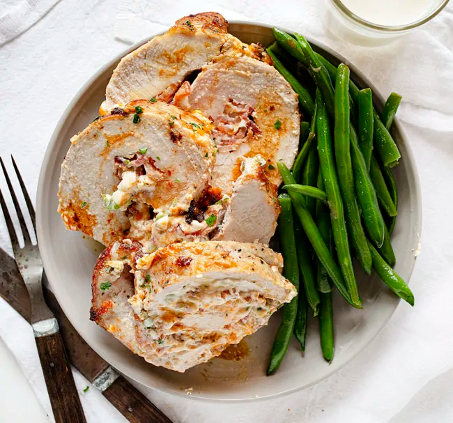 Jalapeno Popper Pork Loin is stuffed with bacon, jalapenos, and cheese, plus filled with protein!