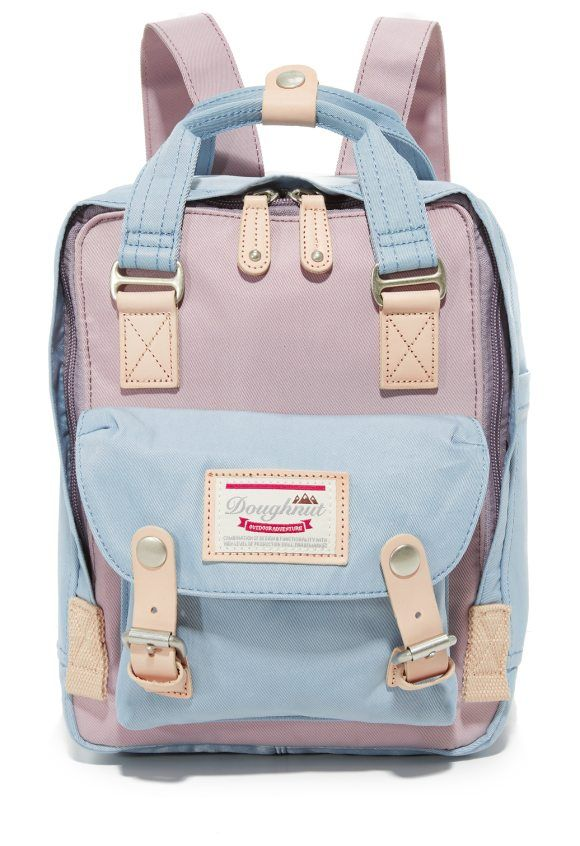 47350f6941 mini macaroon backpack by Doughnut. This Doughnut mini backpack is detailed  with colorblock panels and natural leather trim. Slim pockets trim the  sides