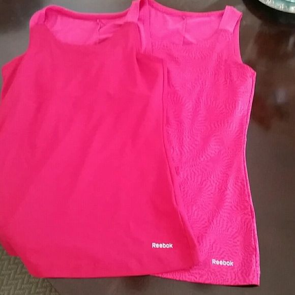 2 gym tanks medium Comes with built in sport bras excellent condition! Reebok Tops Muscle Tees