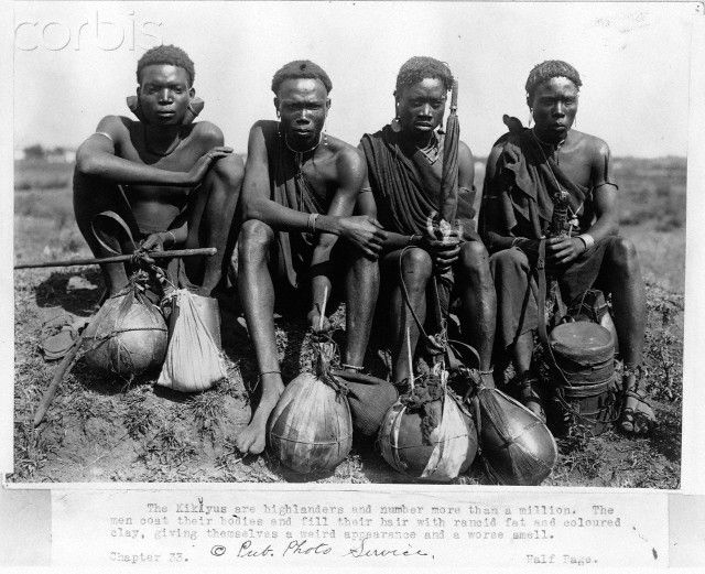 Four Kikuyu men sit on the grass with their water gourds in front of them, Kenya .  Date Photographed: 1920s