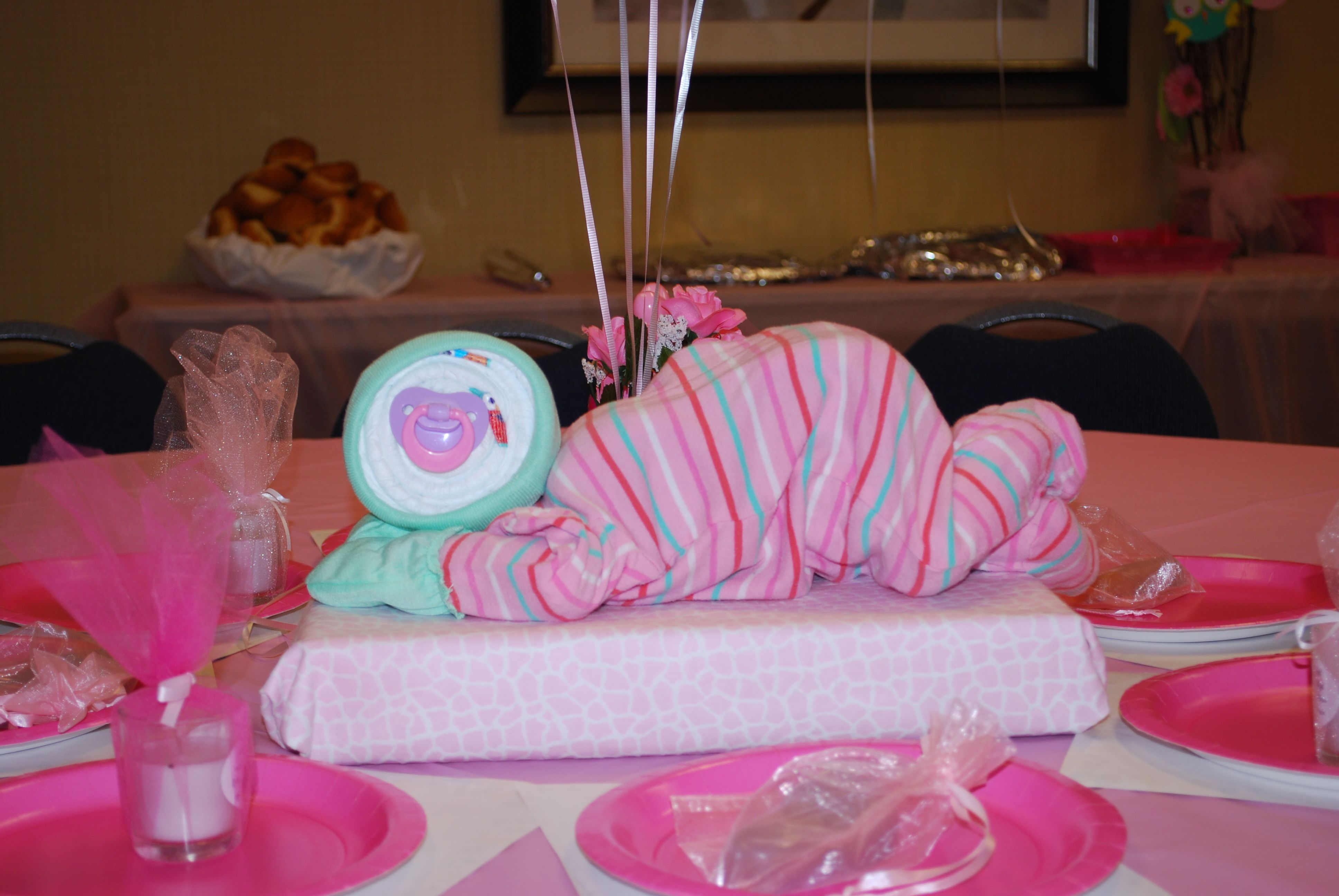 i loved the baby center pieces.  also, all the ITEMS FOR THE GAMES WERE PUT ON THE TABLE BEFORE GUEST ARRIVED.  time saver